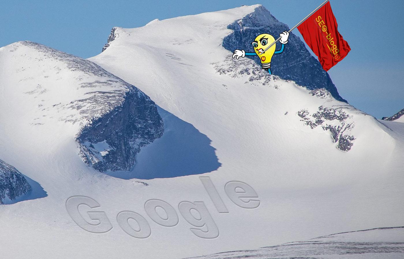 "Maskoten Munter klatrer på Google-toppen. Nederst på fjellet står det ""Google"" i snøen."